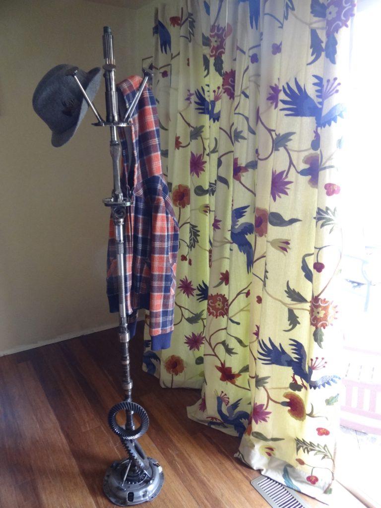 Upright coat rack.